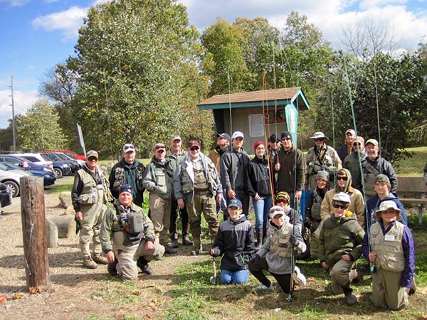 New fly anglers and their instructors gather around Grosjean Park kiosk prior to fly fishing clinic.